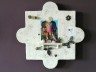 Mandala-wandobject keramiek Marjoke de Heer met accessoires van Anneke Bruin